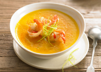 Curried pumpkin soup with butterfly prawns