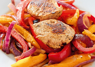 Pork medallions on a bed of peppers